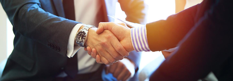 Bank fintech partnership business people handshake