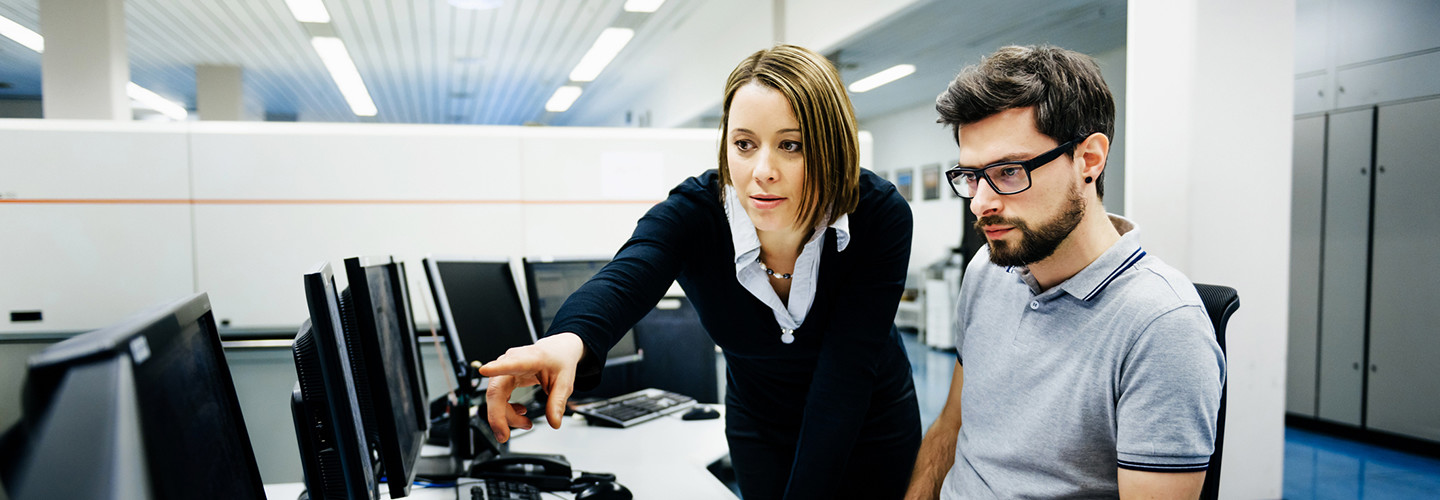 Two IT pros working on cybersecurity