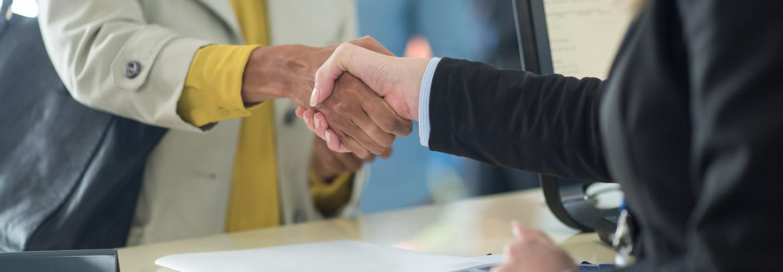 Banker shakes customer's hand