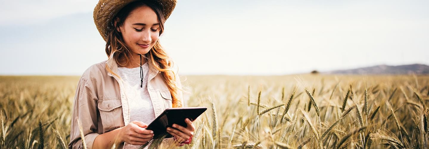 Girl in field with iPad
