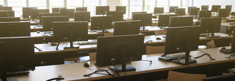 Classroom of many desktop computers.