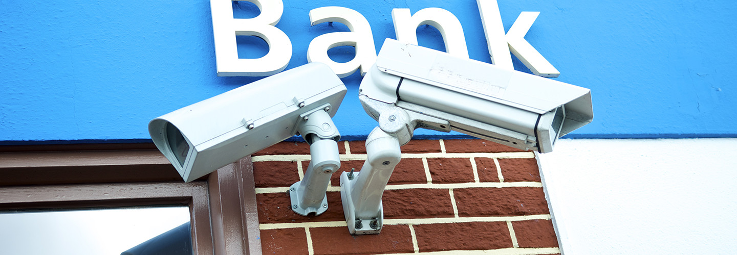 A bank protects its customers with two IP-enabled surveillance cameras