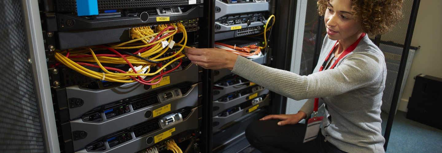 Woman works in a data center