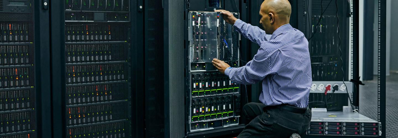 Shot of an IT technician repairing a computer in a data center