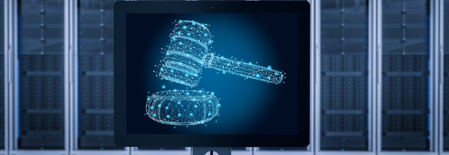 outline of gavel on computer screen with hard drives in the background