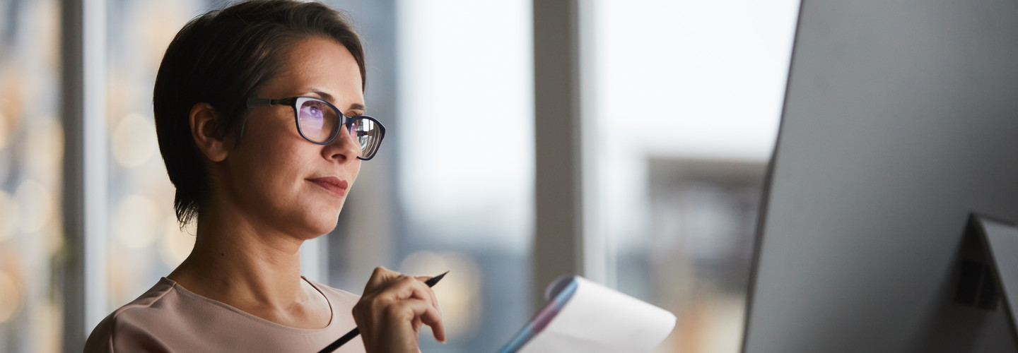 woman taking notes remotely