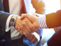 Bank fintech partnership business people handshake