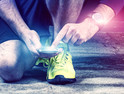 Runner uses mobile phone and smart watch with pulse tracking