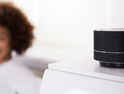 Close-up Of Black Wireless Speaker On Furniture