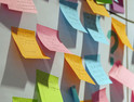 Gathering all the stakeholders on multi-colored sticky notes to generate ideas and create business plans
