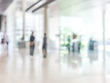bank building lobby blur background interior view toward reception hall, modern luxury white room space with blurry corridor and building glass wall window