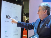 Ian Hutchinson, lead for connected space at Samsung, uses Samsung's pop-up retail store technology.