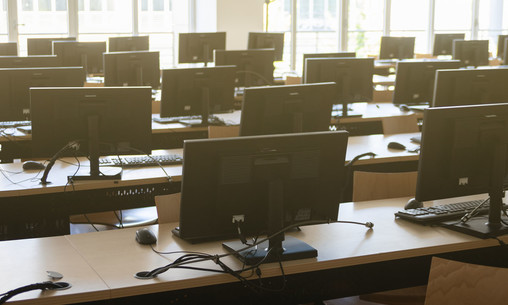 Classroom of many desktop computers.