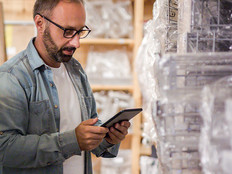 Man using tablet to check retail inventory