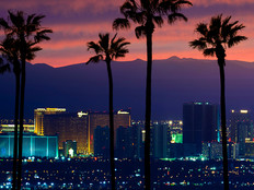 View of the Las Vegas strip skyline at sunset with palm trees