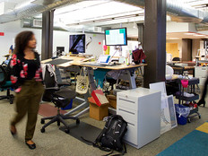 A  wide angle photo people in of the office of the nonprofit Wikimedia Foundation in San Francisco.