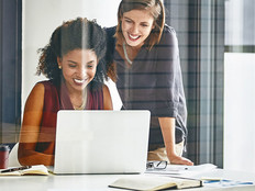 Cropped shot of two businesswomen working together on a laptop in an office