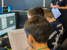 STARBASE instructor Susie Tyson gives directions on how to apply STEM concepts using Morse Code for a potential real-world situation during a two-day STARBASE camp for seventh and graders on Wright-Patterson Air Force base, Ohio, July 11, 2018