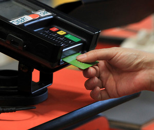 Woman using a smart card to make a purchase
